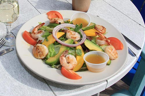 platter with shrimp, avocado, tomato, and onions